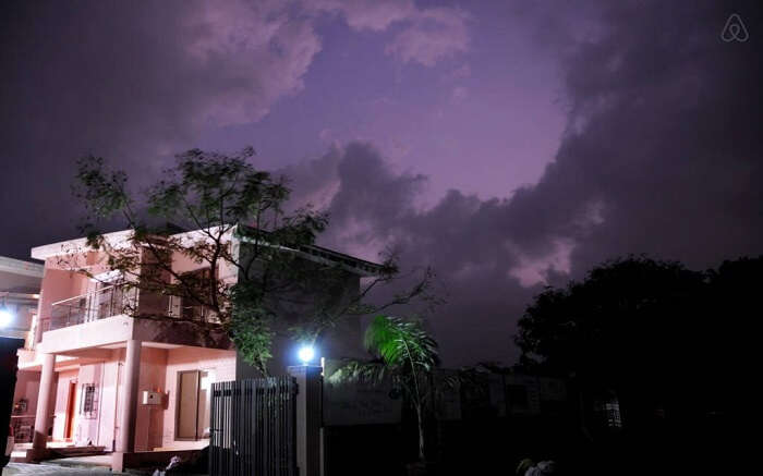 An exterior view of Hill Top Villa in Lonavala at night