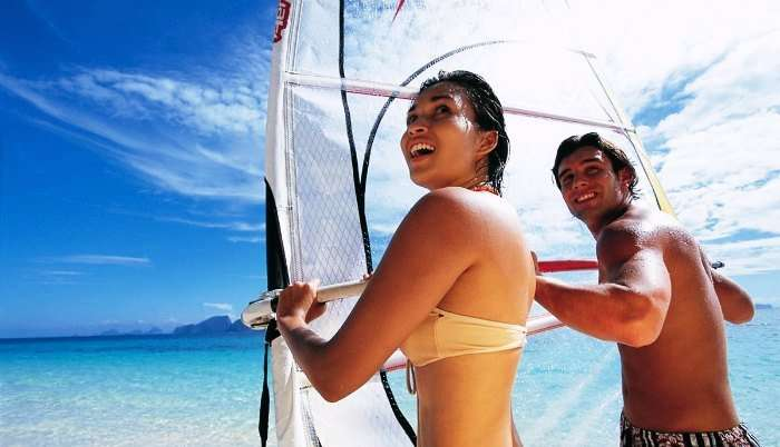 A couple windsurfing in Seychelles