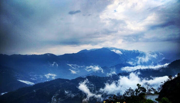 A Mesmerizing View of Clouds and Mountains