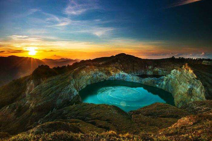 A sunset view of the three-colored Kelimutu Lake in Indonesia