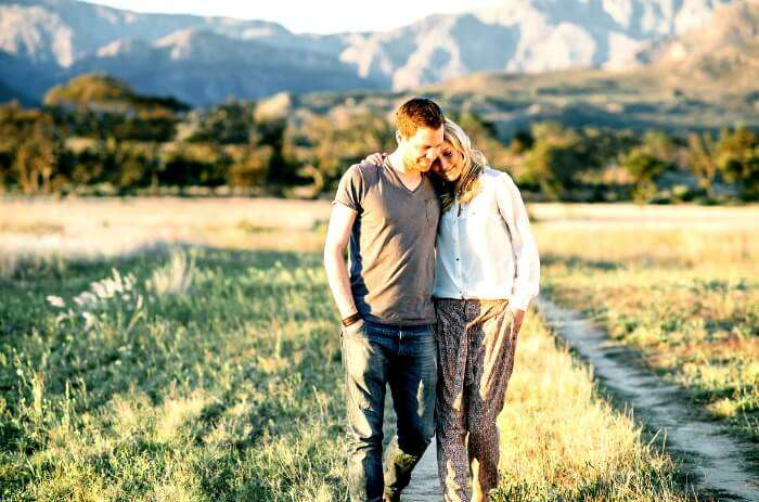 A couple enjoying a romantic walk at Franschhoek - the perfect honeymoon destination in South Africa