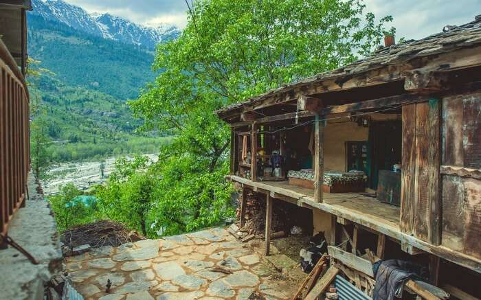 A traditional Himachali house in a Kullu with a beautiful view
