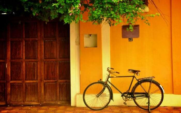 A bicycle parked outside a house in Pondicherry