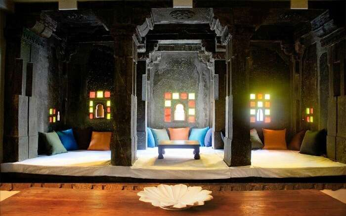 Sitout area decorated with colorful glass windows in Madri Haveli in Udaipur