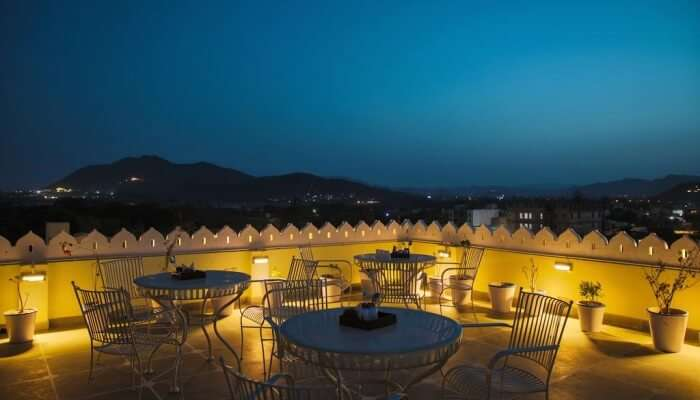 roof-top restaurant with mountainous views in the evening