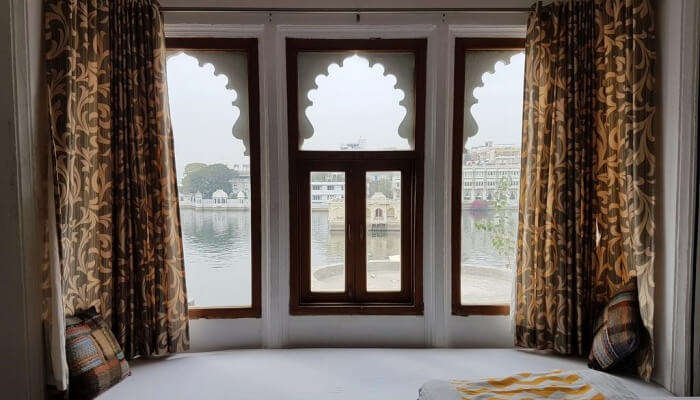 sitting area with window that opens to a beautiful lake view