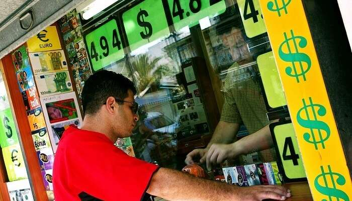 Exchange foreign currency at a local market